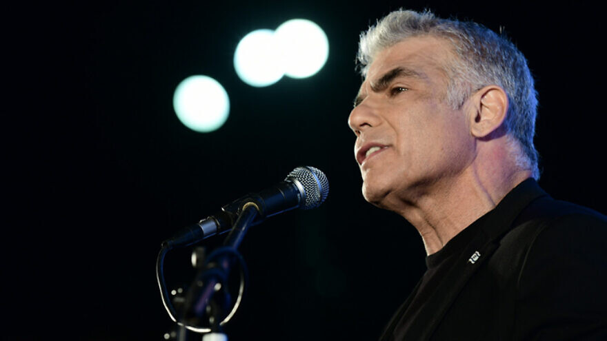 Yesh Atid leader MK Yair Lapid speaks during a protest against Israeli Prime Minister Benjamin Netanyahu at Rabin Square in Tel Aviv on April 19, 2020. Photo by Tomer Neuberg/Flash90.