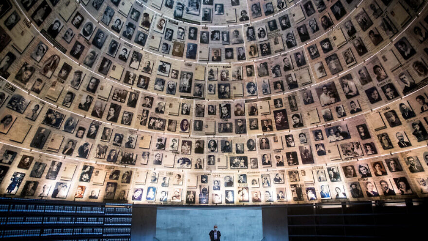 A security guard stands in the empty Hall of Names at the Yad Vashem Holocaust Memorial Museum in Jerusalem on April 19, 2020. Photo by Yonatan Sindel/Flash90.