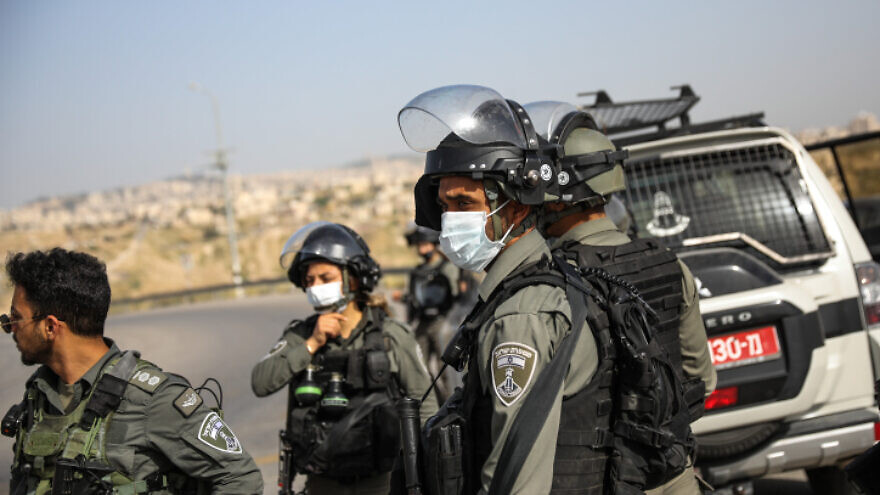 Israeli Border Police officers near the scene of a car-ramming and stabbing terrorist attack at a checkpoint near the Jewish town of Ma'ale Adumim on April 22, 2020. Photo by Olivier Fitoussi/Flash90.