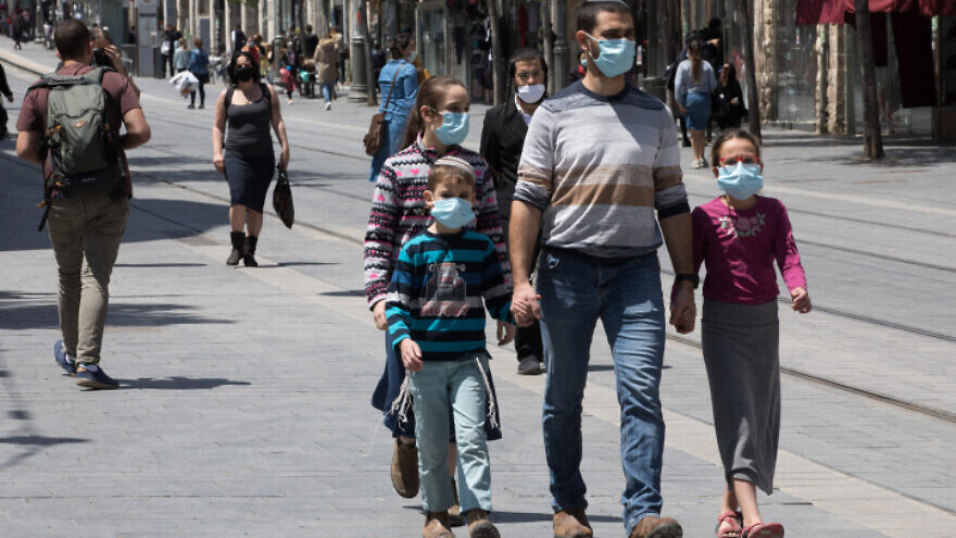 Israelis, face masks required, walk down Jaffa Street in downtown Jerusalem on April 26, 2020. Photo by Nati Shohat/Flash90.