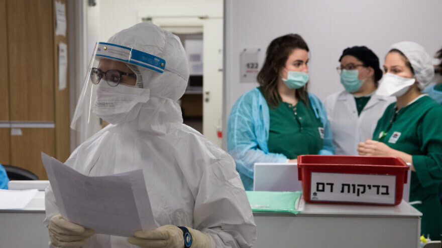 Medical workers at the coronavirus unit in Mayanei Hayeshua Medical Center in Bnei Brak, Israel, prepare a return to other types of procedures as cases of new infection are decreasing, April 27, 2020. Photo by Nati Shohat/Flash90.