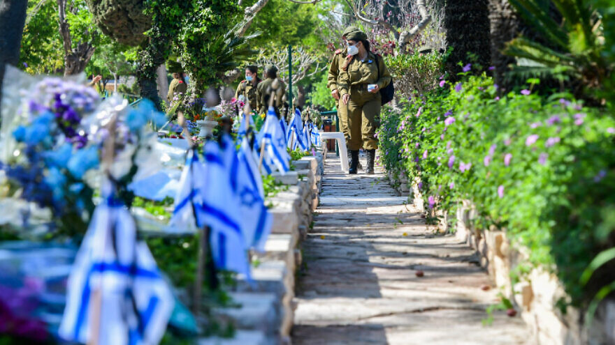 Israeli soldiers are seen at the Kiryat Shaul Military Cemetery as Israel marks its Memorial Day for fallen soldiers and victims of terrorism on April 28, 2020. Photo by Avshalom Sassoni/Flash90.
