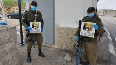 Thousands of soldiers in the Israel Defense Forces received shmurah matzah for Passover, delivered to their bases by Friends of the Israel Defense Forces (FIDF), April 2020. Credit: FIDF.