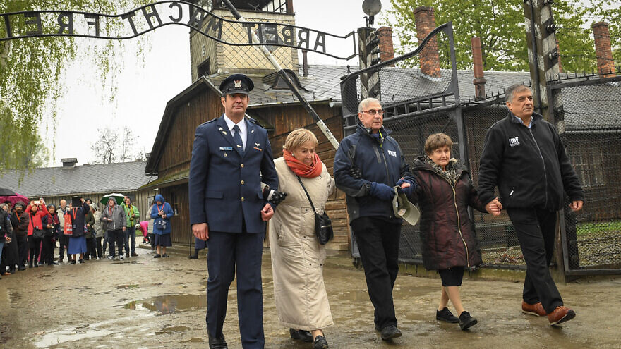 In 2017, Holocaust survivor Bronia Brandman returned to Auschwitz-Birkenau for the first time since her liberation, accompanied by a delegation of officers from the Israel Defense Forces and supporters of Friends of the Israel Defense Forces. Credit: Shahar Azran/FIDF.