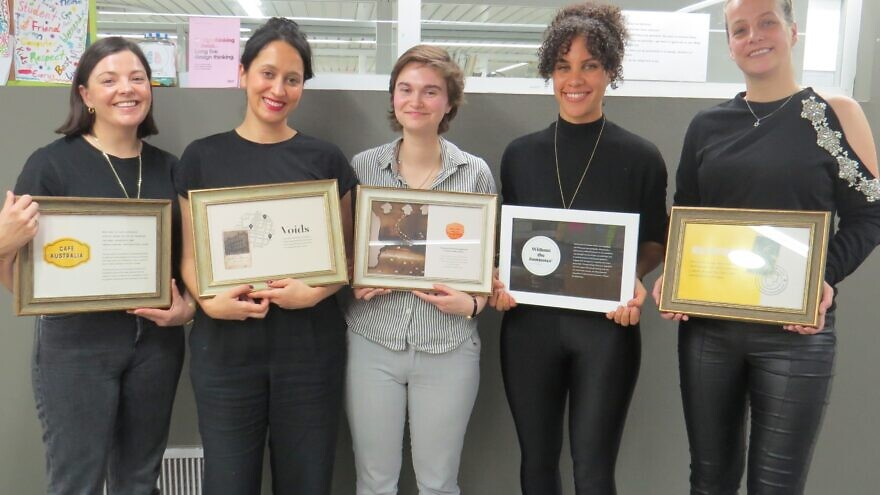 Students from the University of Haifa's Innovation Hub for Holocaust Education and Commemoration pose with plaques describing their individual projects. Credit: University of Haifa.
