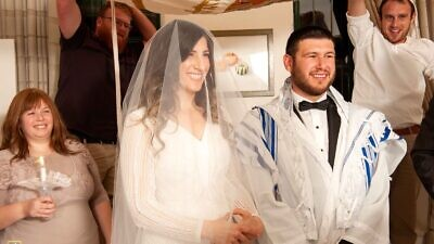 Miriam and Mickey Polevoy celebrating a significantly smaller wedding in Jerusalem due to restrictions from the coronavirus pandemic. Credit: Avigail Tresgallo Photography.