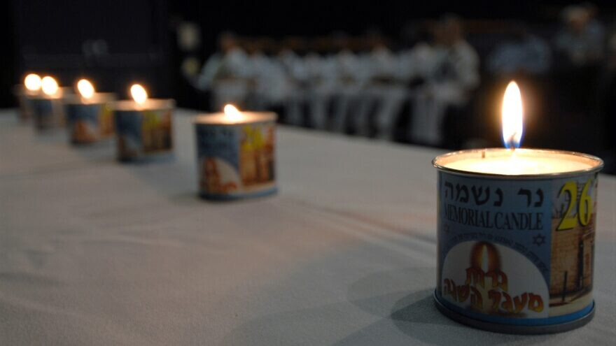 Six memorial candles were lit on board the Naval Station Pearl Harbor during the opening remarks of a remembrance observation to commemorate the lives of more than 6 million Jews lost during the Holocaust, April 26, 2007. U.S. Navy Photo by Mass Communication Specialist 1st Class James E. Foehl.