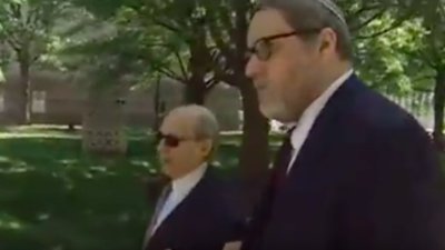 Rabbi Barry Freundel and his lawyer, Jeffrey Harris, enter D.C. Superior Court in Washington, D.C., where Freundel would plead guilty to 52 counts of voyeurism, on May 15, 2015. He was sentenced to six-and-a-half years in prison, but was released early on April 1, 2020, due to the good behavior and the coronavirus pandemic.