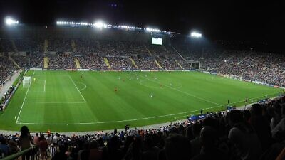 Teddy Stadium in Jerusalem during UEFA U21 final match between Spain and Italy on June 18, 2013. Credit: Dindia via Wikimedia Commons.