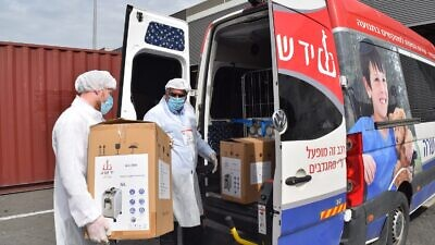 Israeli nonprofit and volunteer organization Yad Sarah, which offers free loans of medical equipment in Israel, recently brought 5,000 oxygen generators, 220 respirators, 10,000 oxygen balloons and 20,000 protective kits with disposable gowns, masks and gloves to Israel from China. Credit: Courtesy.