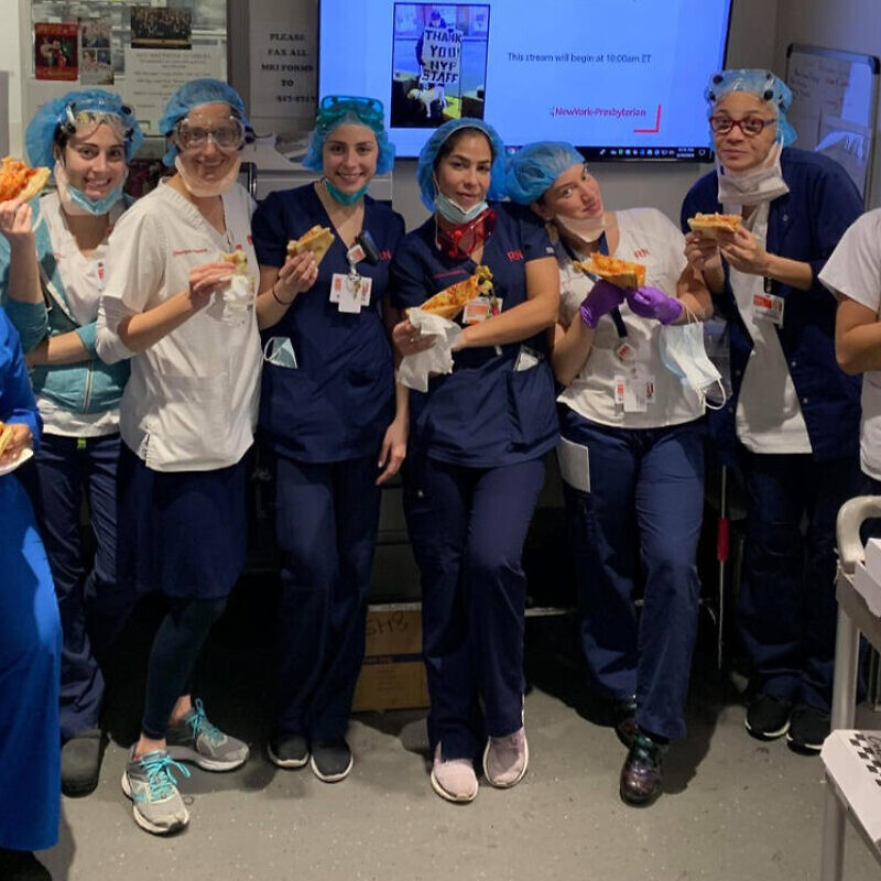 Health-care professionals at New York-Presbyterian Hospital enjoy kosher pizza delivered by Kosher19. Credit: Courtesy.