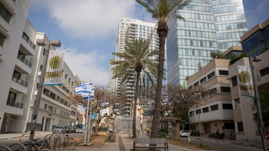 A near-empty Rothschild Boulevard in Tel Aviv. Daily life in Israel has largely come to a halt amid lockdown measures to prevent the spread of coronavirus (COVID-19), on April 18, 2020. Photo by Miriam Alster/Flash90.