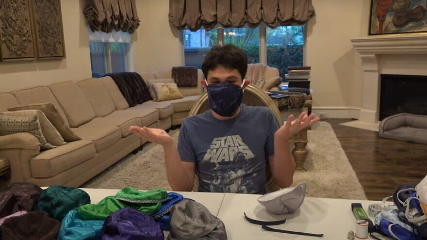 A member of the Jason family from Houston shows off his new protective gear, April 2020. Source: Screenshot.