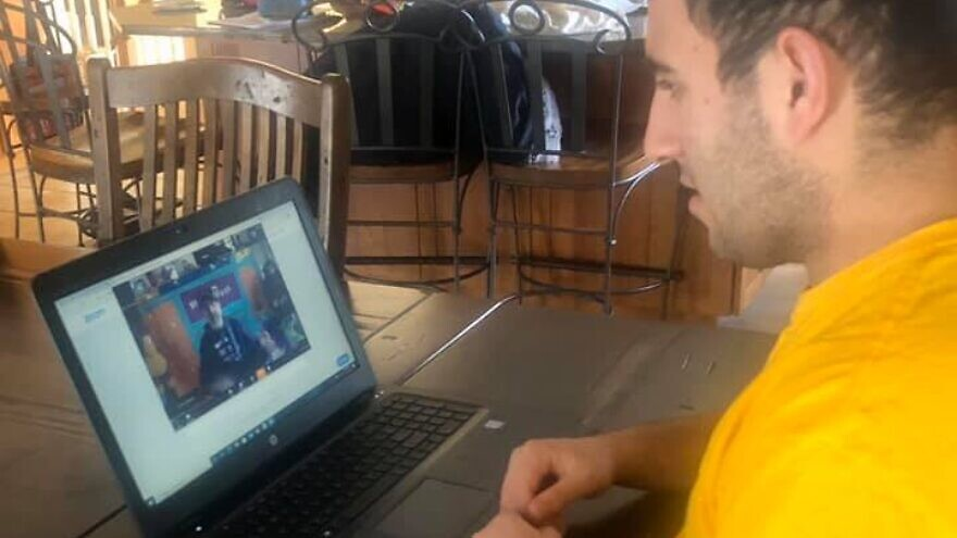 Friendship Circle participant Matthew Goldstein takes part in a Sunday-morning program online from Friendship Circle in Livingston, N.J. Credit: Courtesy.