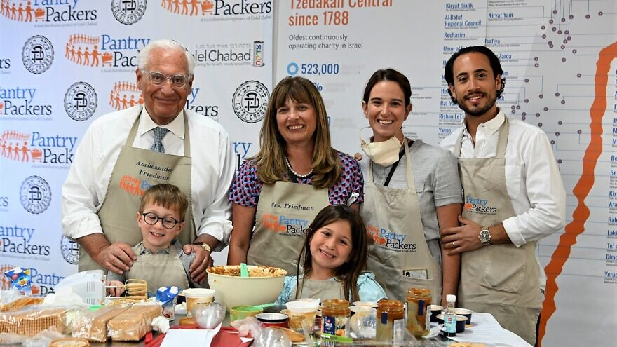 U.S. Ambassador to Israel David Friedman and his family help make cheesecake for families throughout the Jewish state prior to Shavuot at Pantry Packers in Jerusalem, May 26, 2020. Credit: Matty Stern/U.S. Embassy Jerusalem.