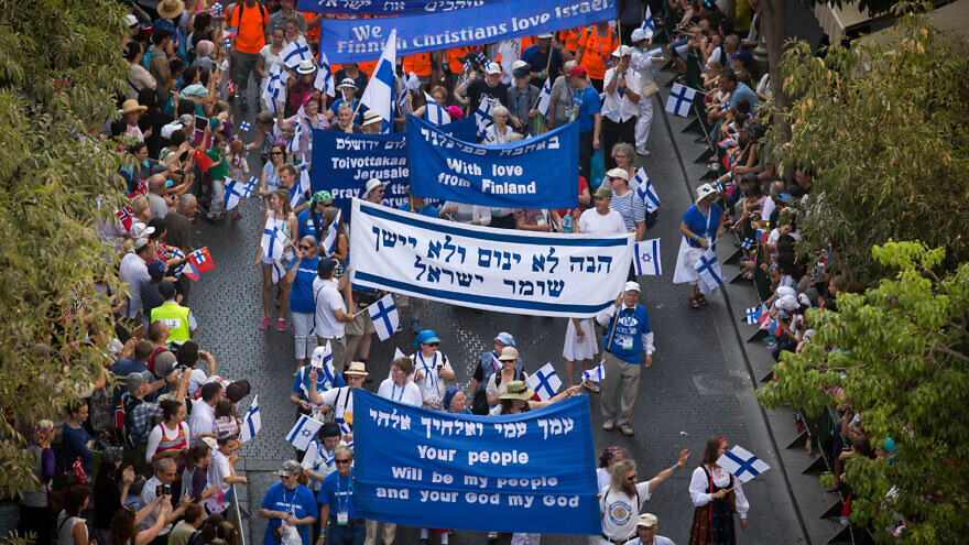 Thousands of Christian evangelists wave their national flag alongside the Israeli one as they march in a parade in the center of Jerusalem, marking the Jewish holiday of Sukkot, the Feast of the Tabernacles. Oct. 1, 2015. Photo by Nati Shohat/Flash90.
