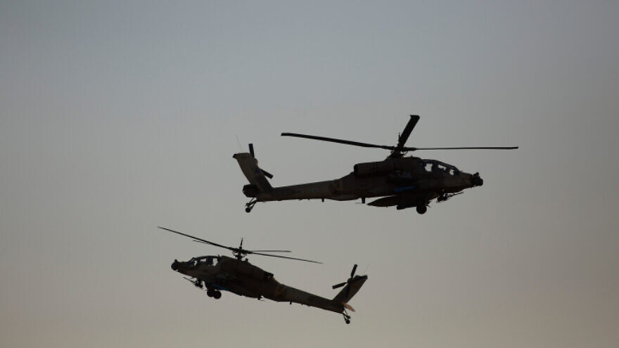 Israeli AH-64 Apache Longbow helicopters take part in an air show for a graduation ceremony at the Hatzerim base in the Negev desert, near the southern Israeli city of Beersheva, on Dec. 31, 2015. Photo by Lior Mizrahi/Flash90.