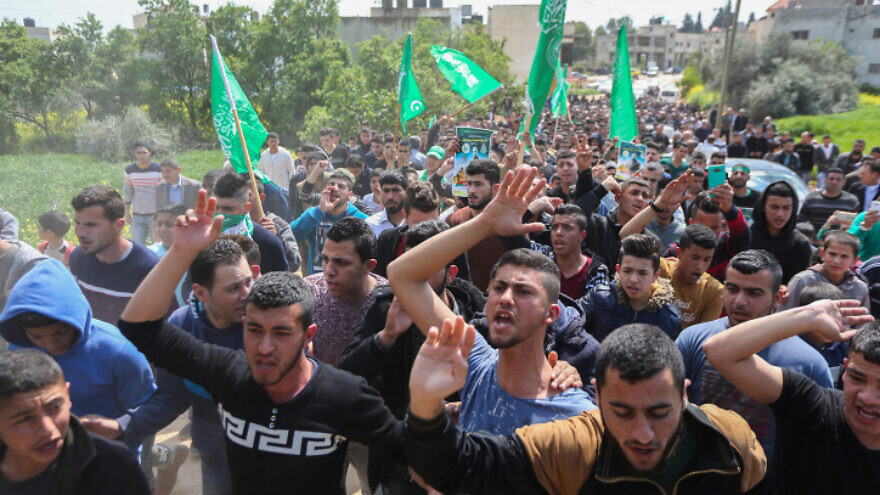 Palestinian supporters of senior Hamas militant Mazen Fuqaha shout slogans during a march in the West Bank village of Tubas, March 25, 2017. Photo by Flash90.