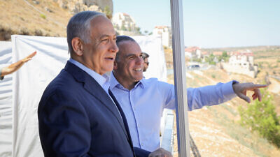 Israeli prime minister Benjamin Netanyahu with Efrat mayor Oded Revivi during a visit to Efrat, in the Gush Etzion area of Judea on July 31, 2019. Photo by Gershon Elinson/Flash90.