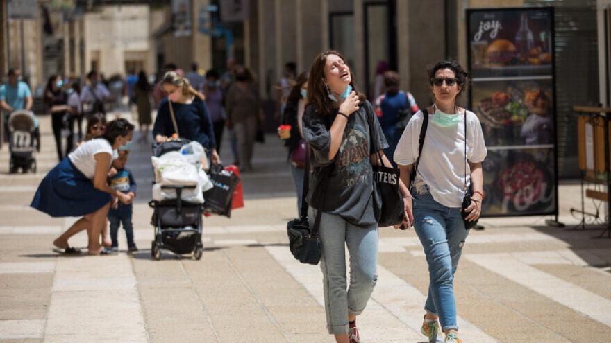 People walk at the Mamilla Mall near Jerusalem's Old City on May 3, 2020. Photo by Nati Shohat/Flash90.