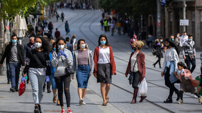 Israelis wear face masks to help protect against the coronavirus as they shop in Jerusalem after the Israeli government eased some lockdown measures it had imposed in order to stop the spread of COVID-19, May 6, 2020. Photo by Olivier Fitoussi/Flash90.