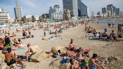 Israelis enjoy the beach in Tel Aviv as temperatures rise to 40 degrees Celsius (more than 100 degrees Fahrenheit) in some parts of the country on May 16, 2020. Photo by Miriam Alster/Flash90.