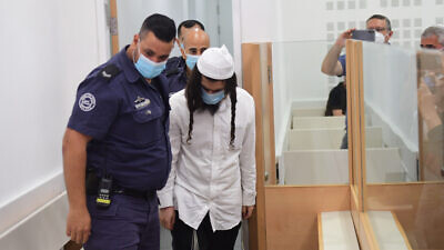 Amiram Ben-Uliel, the main suspect in the July 2015 Duma arson murders in which three members of the Dawabshe family were killed, arrives at the Lod District Court in central Israel to hear his verdict, on May 18, 2020. Photo by Avshalom Sassoni/POOL.