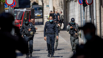 Israel Police guard the scene of the shooting of Iyad Halak at the Lions' Gate in Jerusalem's Old City on May 30, 2020. Photo by Yonatan Sindel/Flash90.