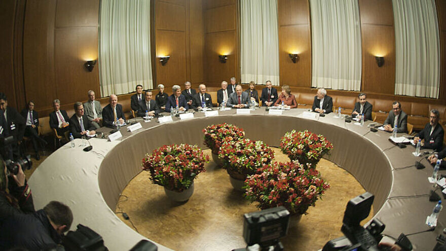 The foreign ministers of Germany, the United Kingdom, China, the United States, France, Russia, the European Union and Iran meet in Geneva on Nov. 24, 2013 for talks on the interim agreement on the Iranian nuclear program. Source: U.S. Department of State.