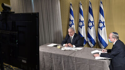 Israeli Prime Minister Benjamin Netanyahu joins a conference call with other world leaders to discuss international travel amid the coronavirus pandemic, May 27, 2020. Photo by Kobi Gideon/GPO.