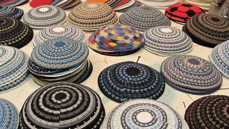 Yarmulkas in all sizes, material and colors. Credit: Wikipedia.
