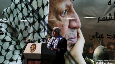 Palestinian Authority leader Mahmoud Abbas addresses a rally in Ramallah commemorating the fifth anniversary of late Palestinian leader Yasser Arafat's death, Nov. 11, 2009. Photo by Issam Rimawi/Flash90.