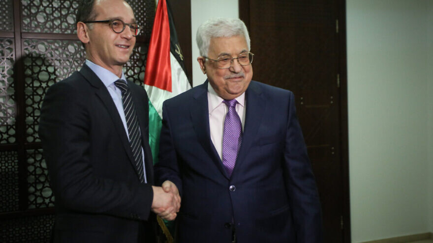 German Foreign Minister Heiko Maas shakes hands with Palestinian Authority leader Mahmoud Abbas during their meeting at the P.A.'s headquarters in Ramallah on March 26, 2018. Photo by Flash90.
