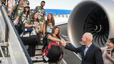 "New immigrants from North America arrive on a special "" Aliyah Flight"" on behalf of the Nefesh B'Nefesh organization, at Ben Gurion Airport in central Israel on Aug. 14, 2019. Photo by Flash90."
