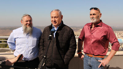 Israeli Prime Minister Benjamin Netanyahu with Gush Etzion Regional Council chairman Shlomo Ne'eman and Jordan Valley regional council chairman David Elchiani on a visit to Alon Shvut in the West Bank, on Nov. 19, 2019. Photo by Gershon Elinson/Flash90.