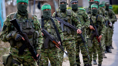 Members of the Izzadin al-Qassam Brigades, the armed wing of Hamas, seen during a patrol in Rafah, in the southern Gaza Strip on April 27, 2020. Photo by Abed Rahim Khatib/Flash90.