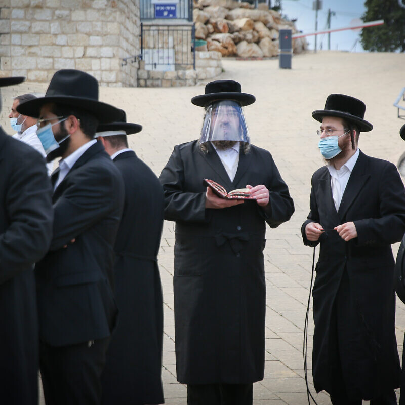 Ultra-Orthodox Jewish men pray in the northern Israeli city of Meron on May 6, 2020. Photo by David Cohen/Flash90.