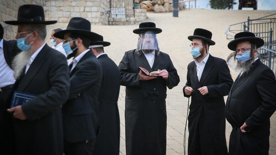 Ultra-Orthodox Jewish men pray in the northern Israeli city of Meron on May 6, 2020. Photo by David Cohen/Flash90.