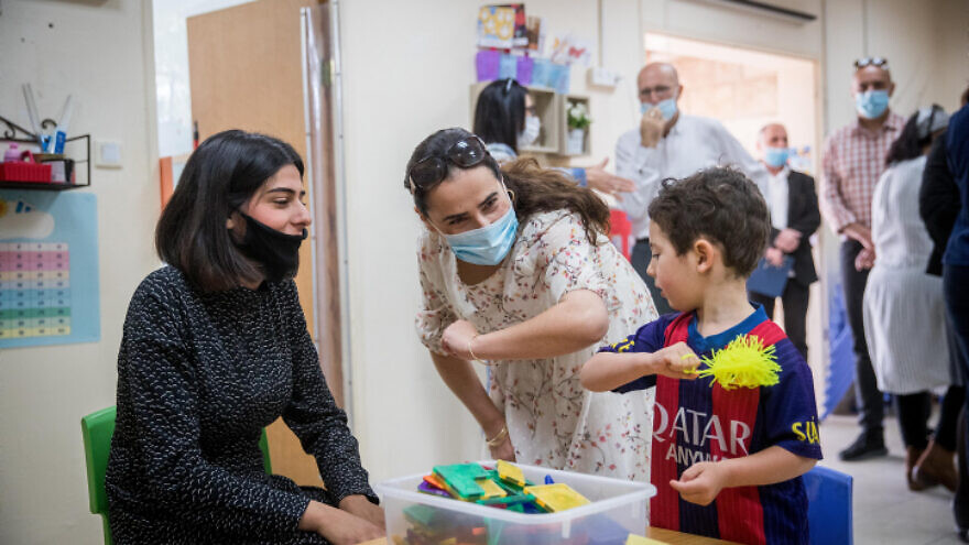 Children and teachers return to the Gan Nayot kindergarten in Jerusalem on May 10, 2020, for the first time in two months, after being hut down due to the COVID-19 pandemic. Photo by Yonatan SIndel/Flash90.