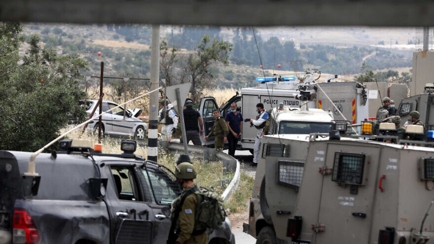 Israeli soldiers at the scene of what the Israeli military says was a deliberate car-ramming attack near the Hebron Hills in Judea and Samaria on May 14, 2020. Photo by Wisam Hashlamoun/Flash90.