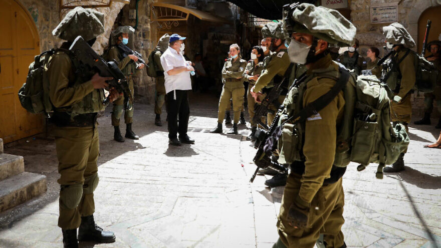 Israeli forces guard as Jews tour the city of Hebron on May 16, 2020. Photo by Wisam Hashlamoun/Flash90.