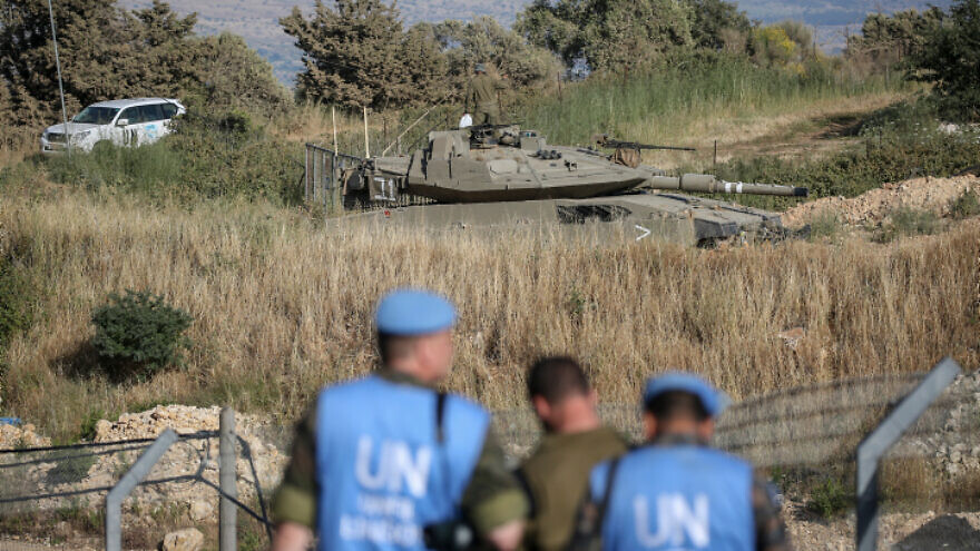 """An Israeli Merkava tank takes part in routine maneuvers near the """"blue line"""" drawn by the U.N. to mark Israel's withdrawal from southern Lebanon in 2000, June 2, 2020. Photo by David Cohen/Flash90."""
