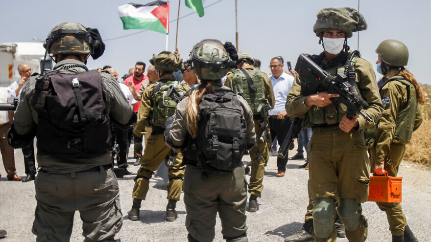 Israeli security forces guard a Palestinian protest in the West Bank against the Jewish state's plans to declare sovereignty over parts of Judea and Samaria. June 5, 2020. Photo by Nasser Ishtayeh/Flash90.