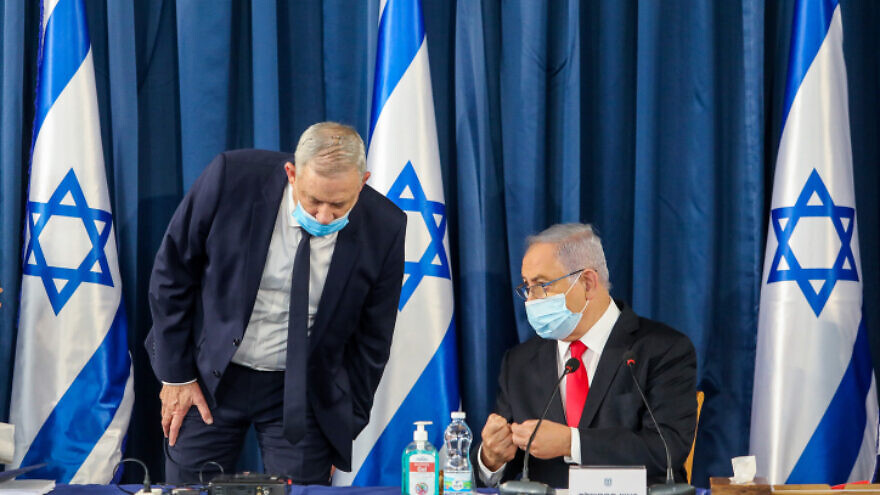 Israeli Prime Minister Benjamin Netanyahu (seated) and Vice Prime Minister Benny Gantz lead the weekly Cabinet meeting, in Jerusalem on June 7, 2020. Photo by Marc Israel Sellem/POOL.
