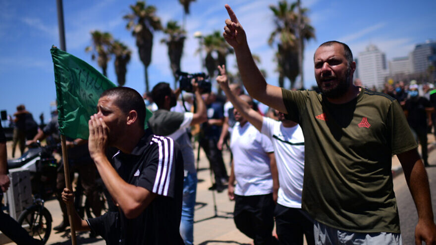 Arab citizens protest against the decision by the Tel Aviv Municipality to demolish a former Muslim burial ground to make way for a new homeless shelter and commercial space, June 12, 2020. Photo by Tomer Neuberg/Flash90.