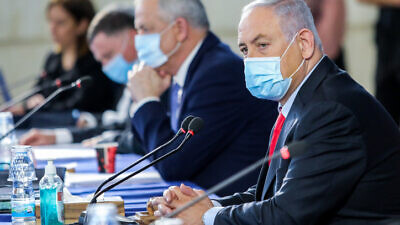 Israeli Prime Minister Benjamin Netanyahu and Vice Premier Benny Gantz at the weekly cabinet meeting, at the Foreign Ministry in Jerusalem on June 14, 2020. Photo by Marc Israel Sellem/POOL.