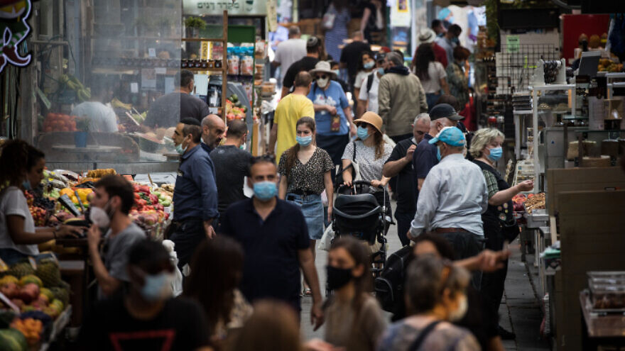 People shop for food at the Machane Yehuda Market in Jerusalem on June 17, 2020. Photo by Yonatan Sindel/Flash90.