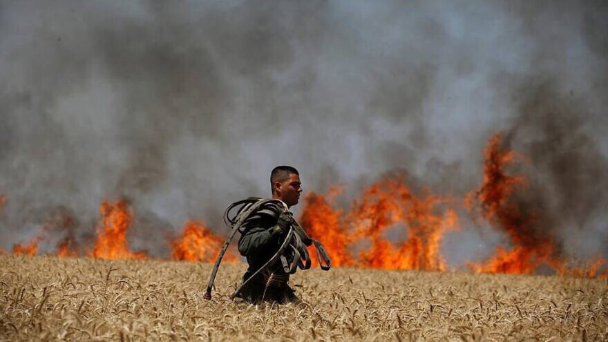 Israeli firefighters put out flames in southern Israel near the border with the Gaza Strip in 2019. Credit: JNF-USA.
