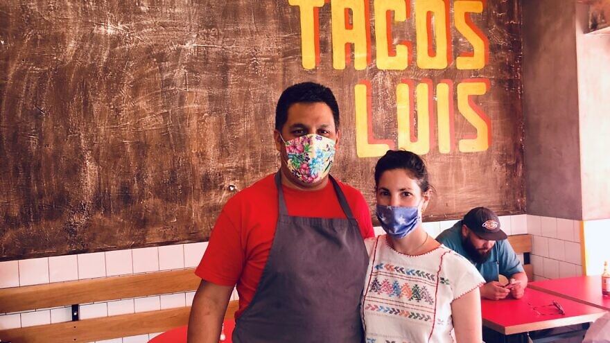 """Jerusalem restaurant owner Luis Cruz and his wife, Leah, at Taco Luis. After being open for just two years, Cruz said the business was """"amazing and profitable."""" Now, he reported, """"we feel like we need to start over again."""" Photo by Eliana Rudee."""