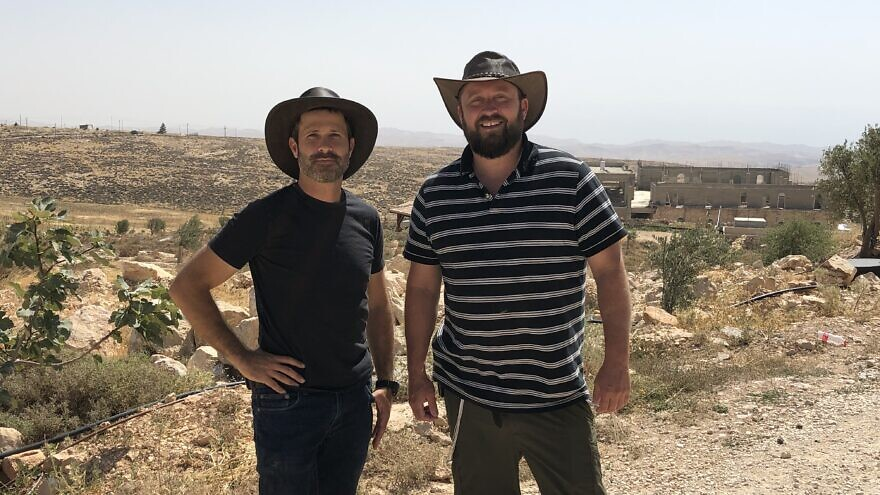 Jeremy Gimpel (left) and Ari Abramowitz on their property, Arugot Farms, in the Judean Desert. Photo by Josh Hasten.